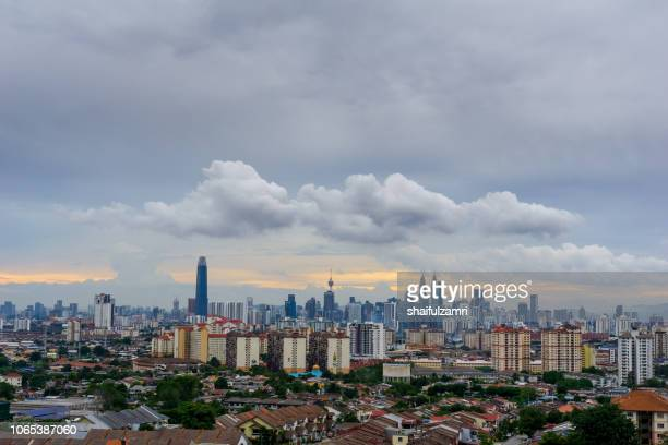 Cloudy sunset over Kuala Lumpur, capital of Malaysia. Its modern skyline is dominated by the 451m tall KLCC, a pair of glass and steel clad skyscrapers.