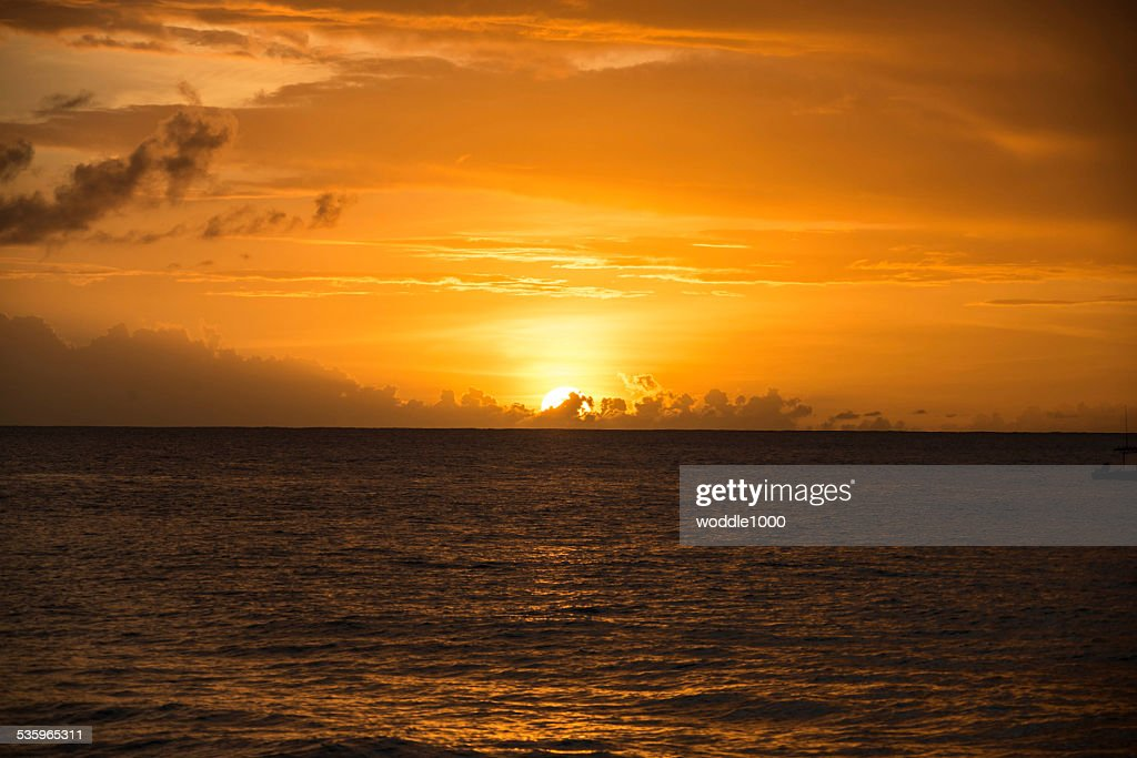 cloudy sunset over the sea : Stock Photo