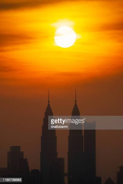 cloudy sunset view over down town kuala lumpur, malaysia. - shaifulzamri stock pictures, royalty-free photos & images