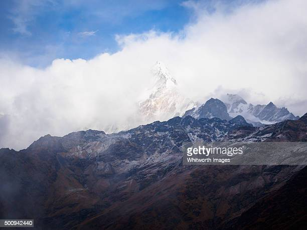 cloudy view to annapurna south from khopra dada, nepal - annapurna south stock photos and pictures