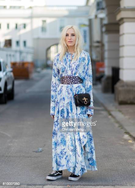 Cloudy Zakrocki wearing blue white dress with pattern and belt Vans during the MercedesBenz Fashion Week Berlin Spring/Summer 2018 at...