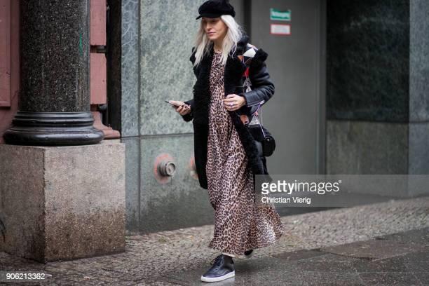 Cloudy Zakrocki wearing leopard print dress flat cap black coat is seen outside Lana Mueller during the Berlin Fashion Week January 2018 on January...