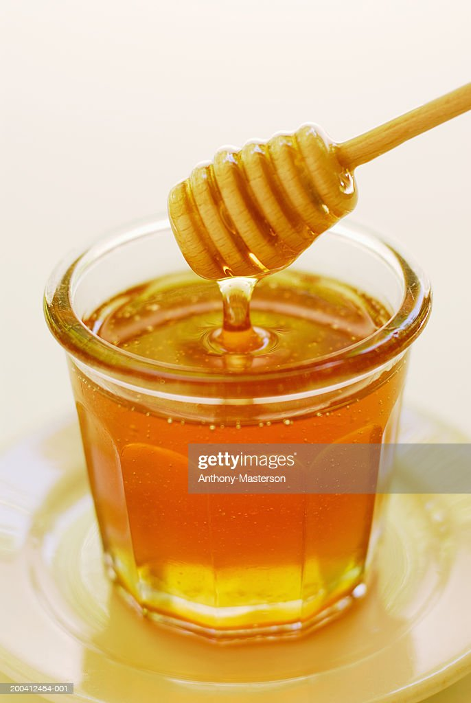 Clover honey in jam jar with dipper : Stock Photo