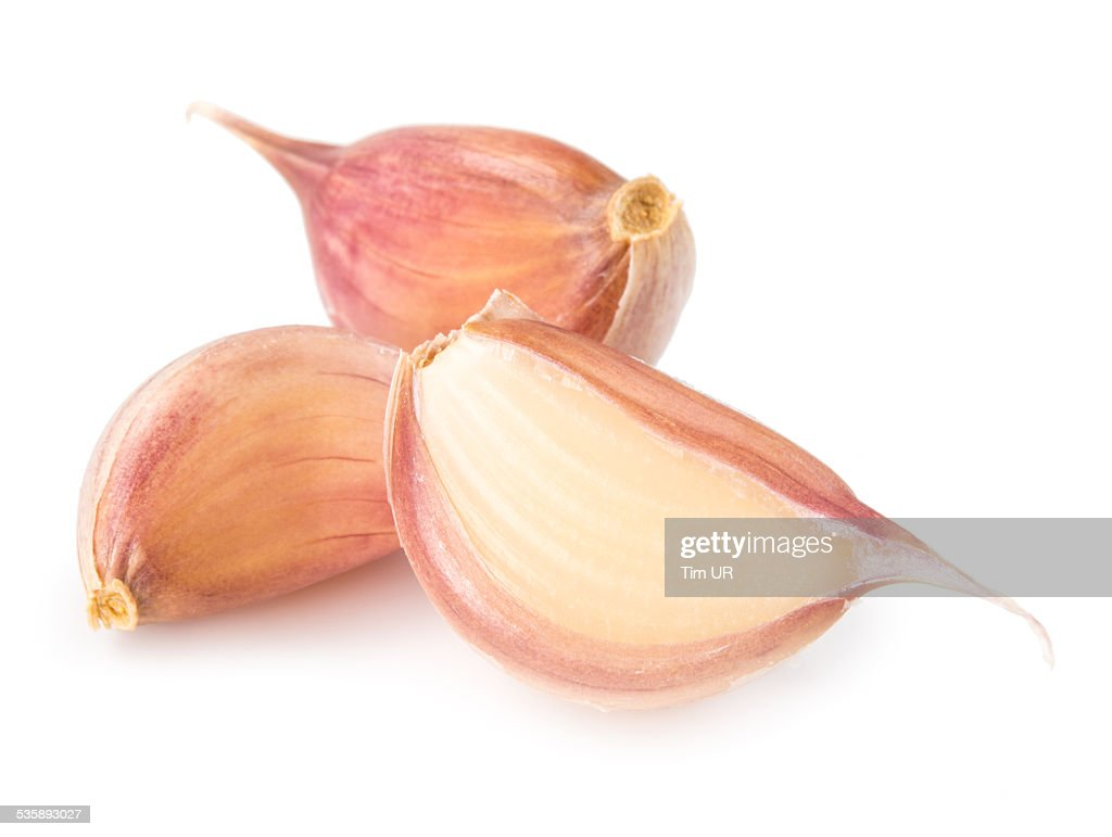 Cloves of garlic isolated on white background : Stock Photo