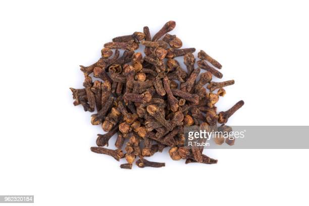 Cloves spice pile isolated on a white background