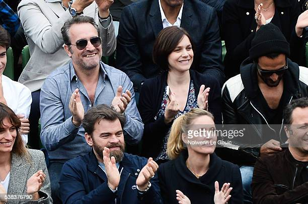 Clovis Cornillac and Jean Dujardin and Nathalie Pechalat during the day fifteen of the French Open 2016 at Roland Garros on June 5 2016 in Paris...