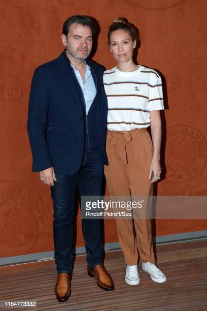 Clovis Cornillac and Lilou Fogli attend the 2019 French Tennis Open Day Fifteen at Roland Garros on June 09 2019 in Paris France
