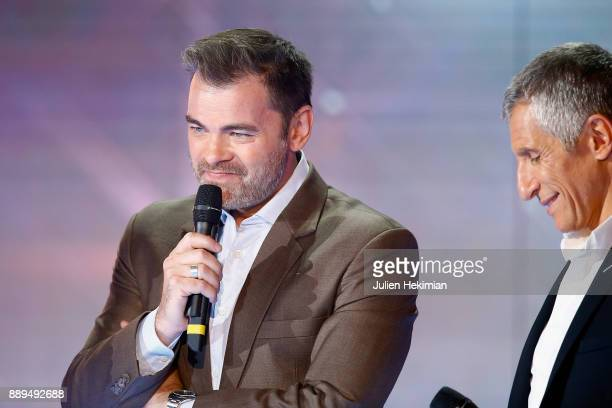 Clovis Cornillac and Nagui perform on stage during the 31st France Television Telethon at Pavillon Baltard on December 9 2017 in NogentsurMarne France