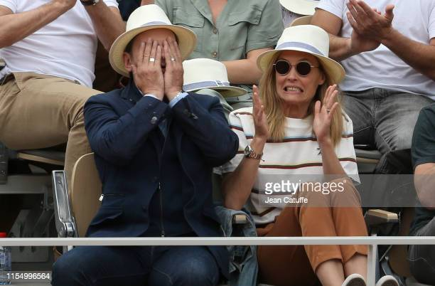 Clovis Cornillac and wife Lilou Fogli attend the men's final during day 15 of the 2019 French Open at Roland Garros stadium on June 9 2019 in Paris...