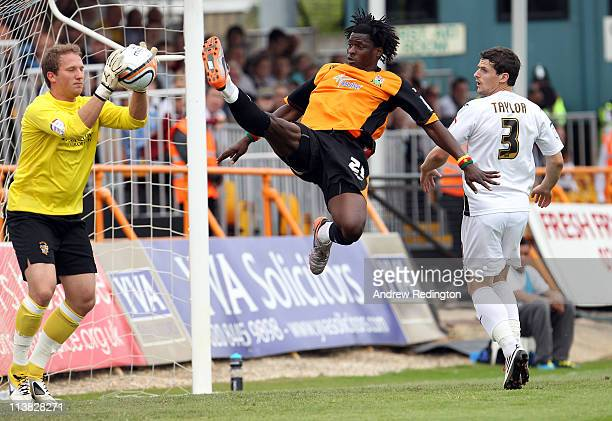 Clovis Kamdjo of Barnet challenges Port Vale's goalkeeper Chris Martin during the npower League Two match between Barnet and Port Vale at Underhill...