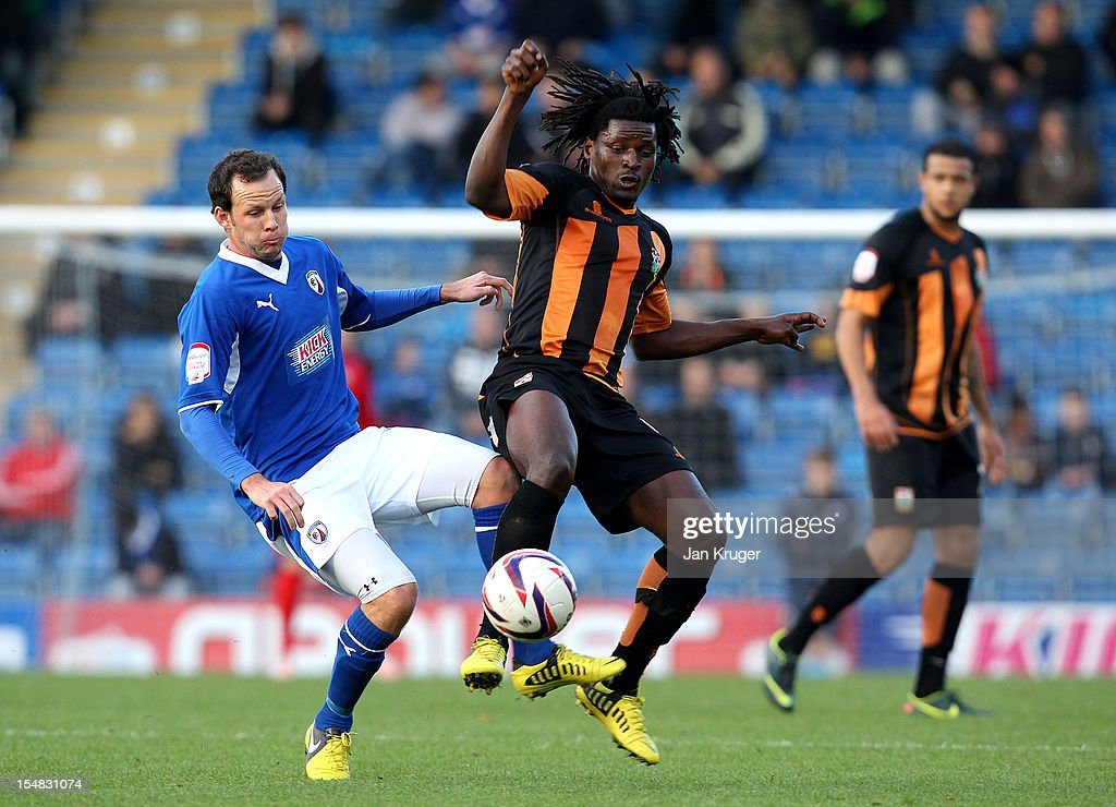 Clovis Kamdjo (C) of Barnet FC battles with Sam Togwell (L) of Chesterfield during the npower League Two match between Chesterfield and Barnet at Proact Stadium on October 27, 2012 in Chesterfield, England.