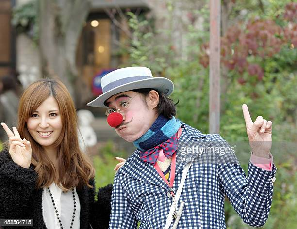 Clown and Japanese woman in streets of Arashiyama,Japan