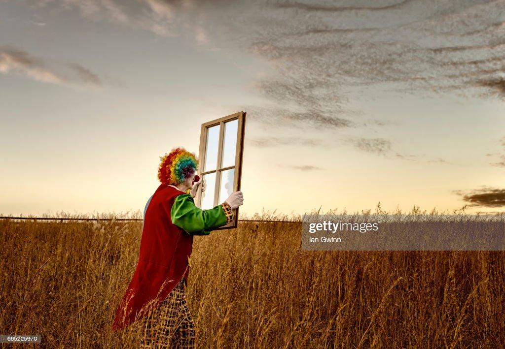 Clown and Window : Stock Photo