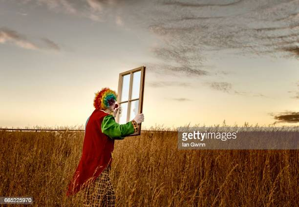clown and window - ian gwinn stock pictures, royalty-free photos & images