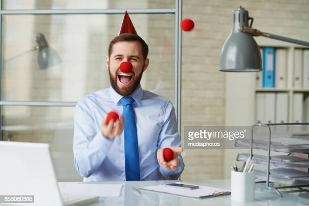 clown at office - clown's nose stock photos and pictures