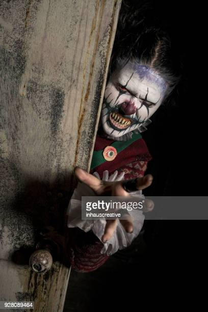 clown behind closet door - scary clown stock photos and pictures