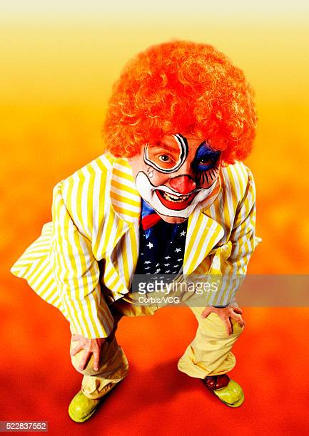 clown bending down and smiling - happy clown faces stock photos and pictures
