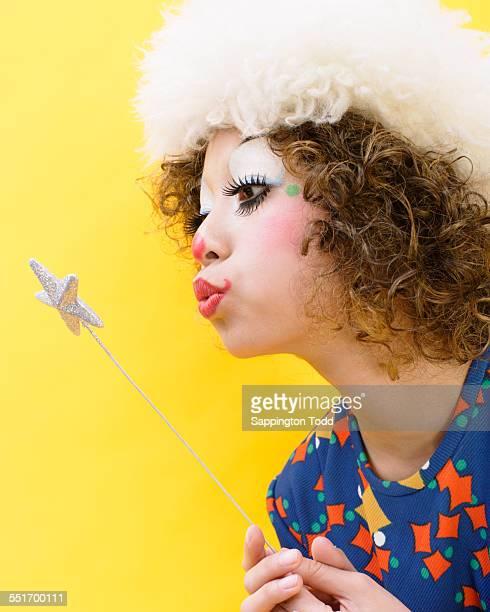 Clown Blowing On Magic Stick