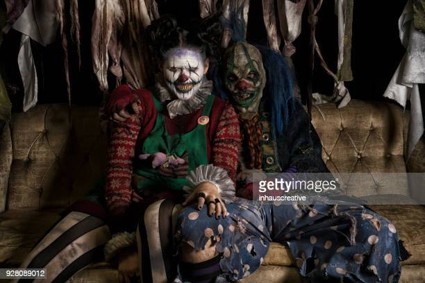 clown couple - scary clown stock photos and pictures