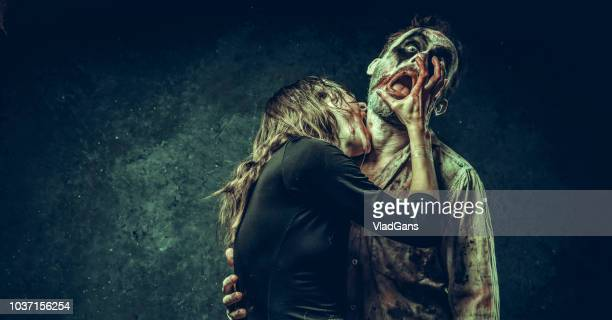clown couple relationship - scary clown stock photos and pictures