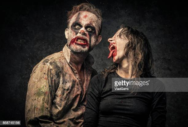 clown couple relationship - zombie face stock photos and pictures