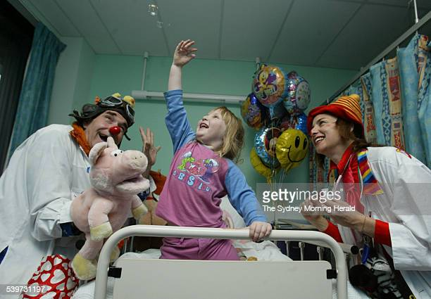 Clown Doctors Dr S Duffer right and Dr NutCase with four year old patient Sasha Lees who was involved in a car accident at Sydney Childrens Hospital...