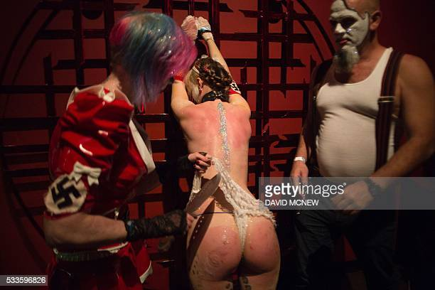Clown dominatrix Dutchess and Matlock dominate voluntary submissive Hello Kitty at a dungeon party during the DomCon LA domination convention on May...
