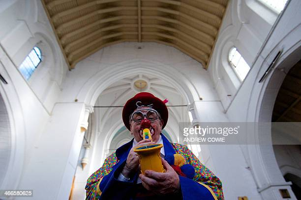 A clown entertains children during a service in memory of celebrated clown Joseph Grimaldi at a church in Dalston East London on February 2 2014 The...