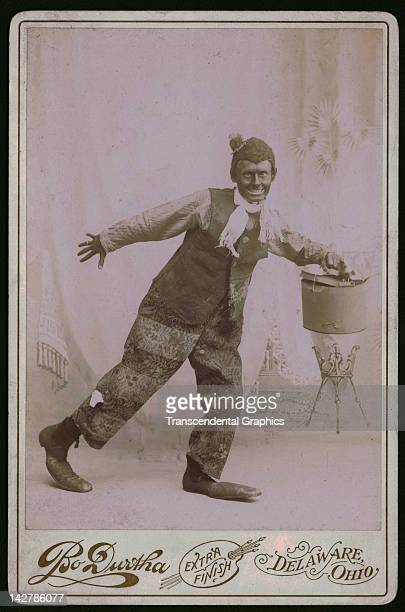 Clown in blackface strikes a weird pose in this cabinet photograph from Delaware, Ohio around 1890.