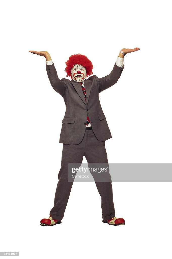 Clown in business suit lifting : Stockfoto