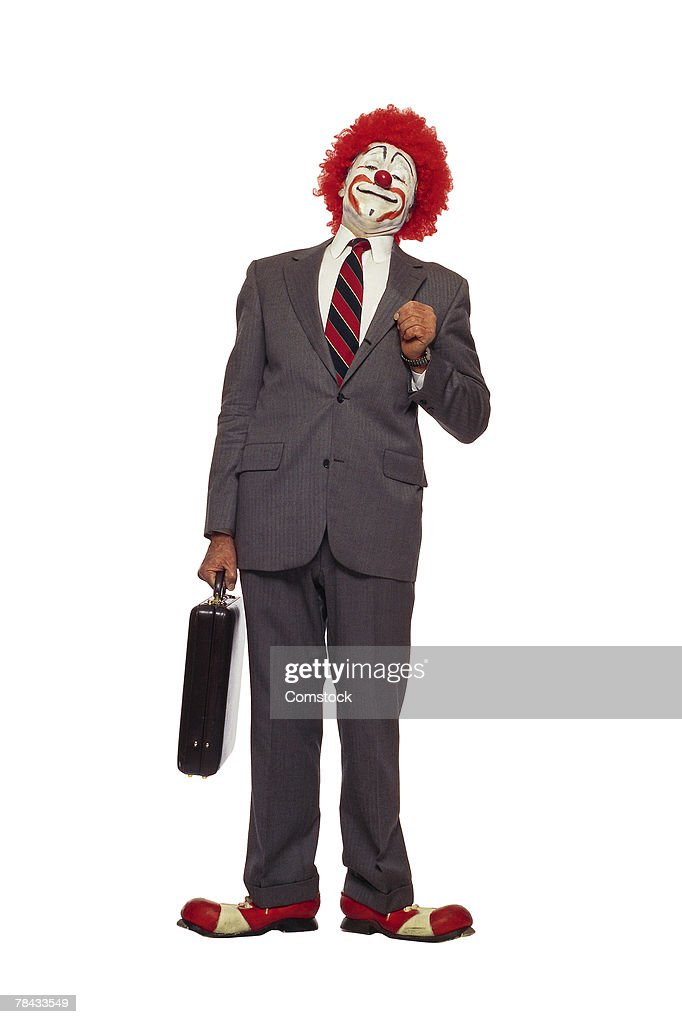 Clown in business suit with briefcase : Stockfoto