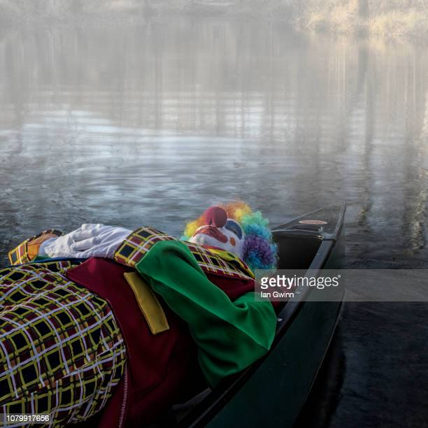 clown in canoe_2 - ian gwinn stock pictures, royalty-free photos & images