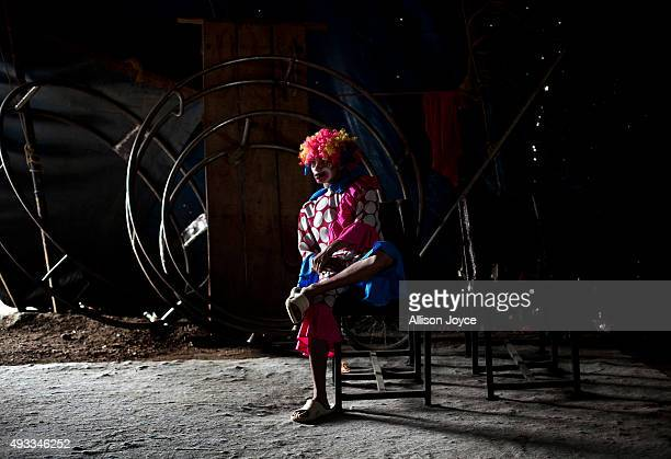 A clown in costume waits quietly backstage before a show on October 17 2015 at the Rambo Circus in Pimpri India The Rambo Circus travels throughout...