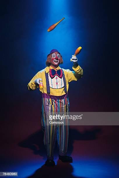Clown juggling pins