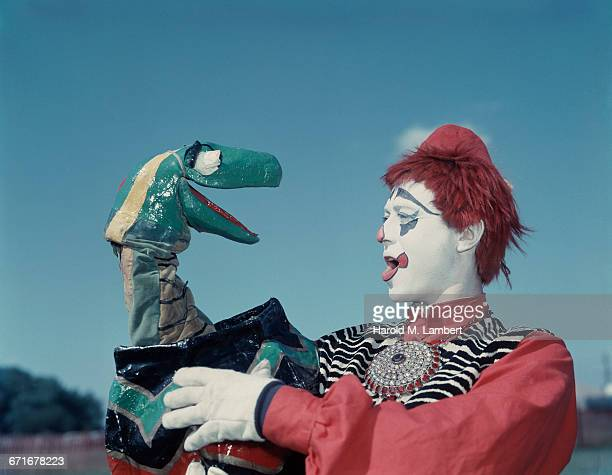 Clown Looking At Puppet