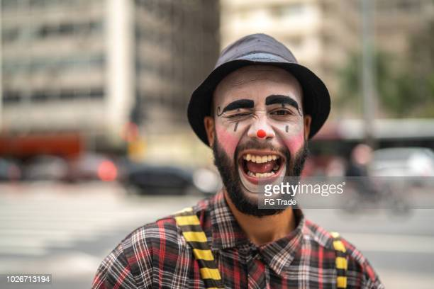 clown makes funny face - happy clown faces stock photos and pictures