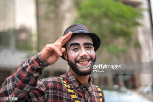 clown making gesture with hands - portrait - clown stock pictures, royalty-free photos & images