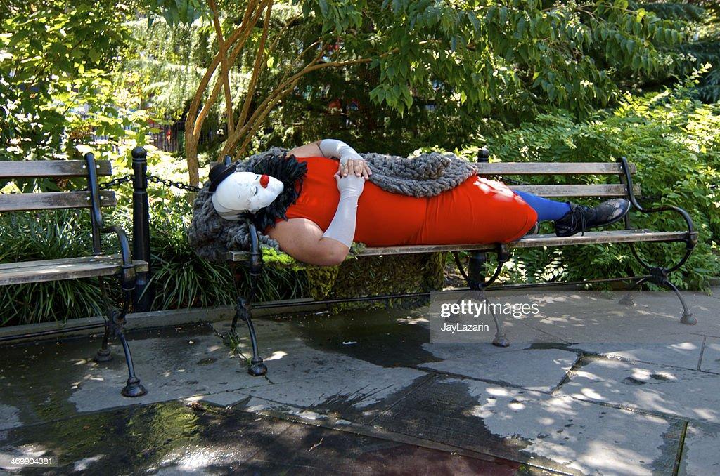 Clown Napping On Park Bench Manhattan New York City Stock Photo