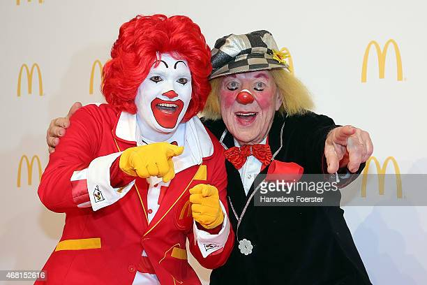 Clown Oleg Popov and Ronald McDonald pose during the new McDonald's Flagship Restaurant reopening at Frankfurt International Airport Terminal 2 on...