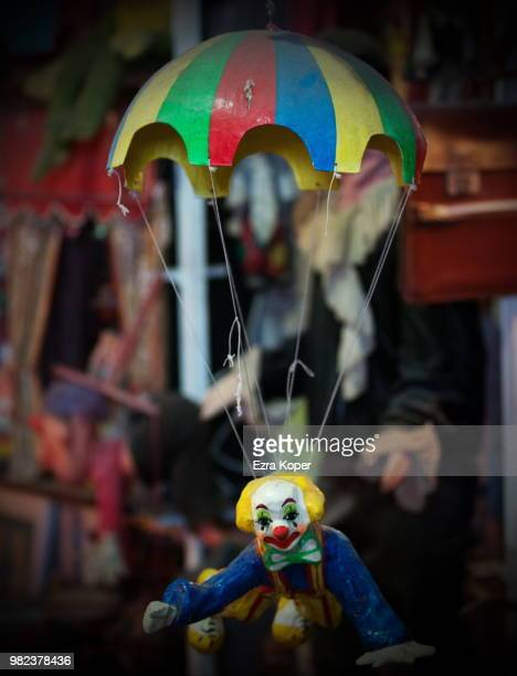 clown on a string - koper stock photos and pictures