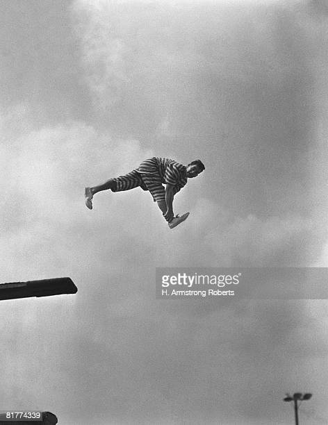 Clown on diving board. (Photo by H. Armstrong Roberts/Retrofile/Getty Images)