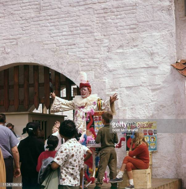 A clown performs for children in front of the Belgian Village during the World's Fair in Queens New York New York June 1965