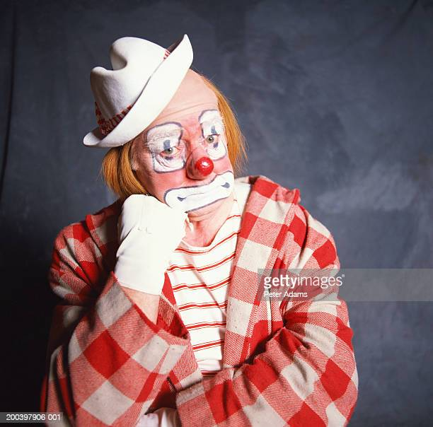 clown resting chin on fist, portrait - sad clown stock photos and pictures