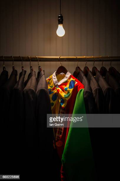 clown suit in closet - ian gwinn stock photos and pictures