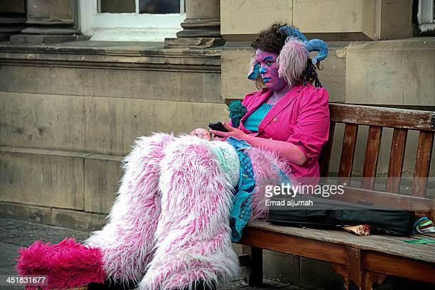 CONTENT] Clown taking rest and checking messages after long day at Edinburgh Festival Fringe 2013