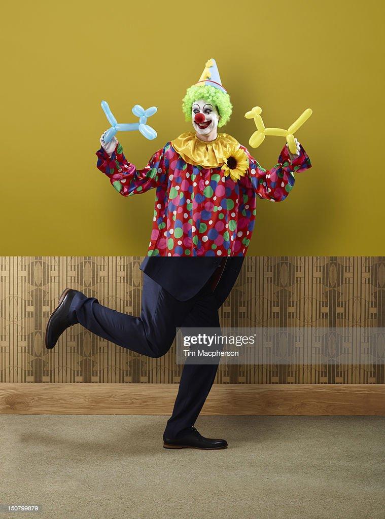 Clown top, business man bottom : Bildbanksbilder