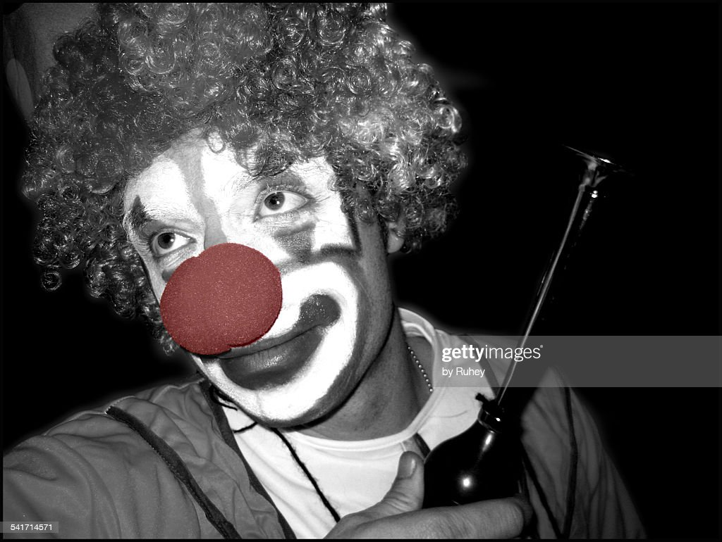 Clown with a horn : Stock Photo