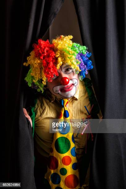 Clown with stage curtains