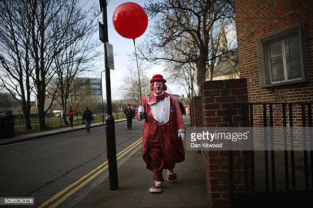 Clowns arrive ahead of the 70th anniversary Clown Church Service at All Saints Church in Haggerston on February 7 2016 in London England Clowns...