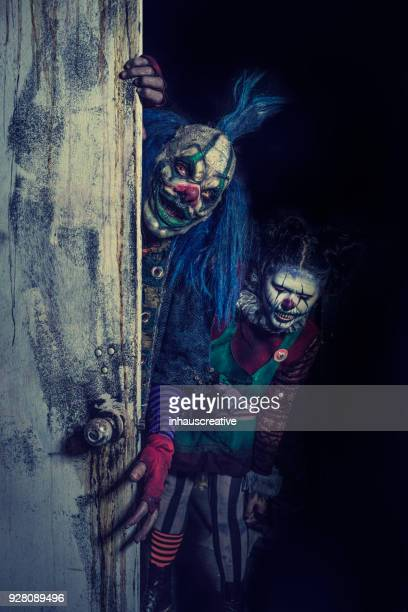 clowns coming out of your closet - scary clown stock photos and pictures